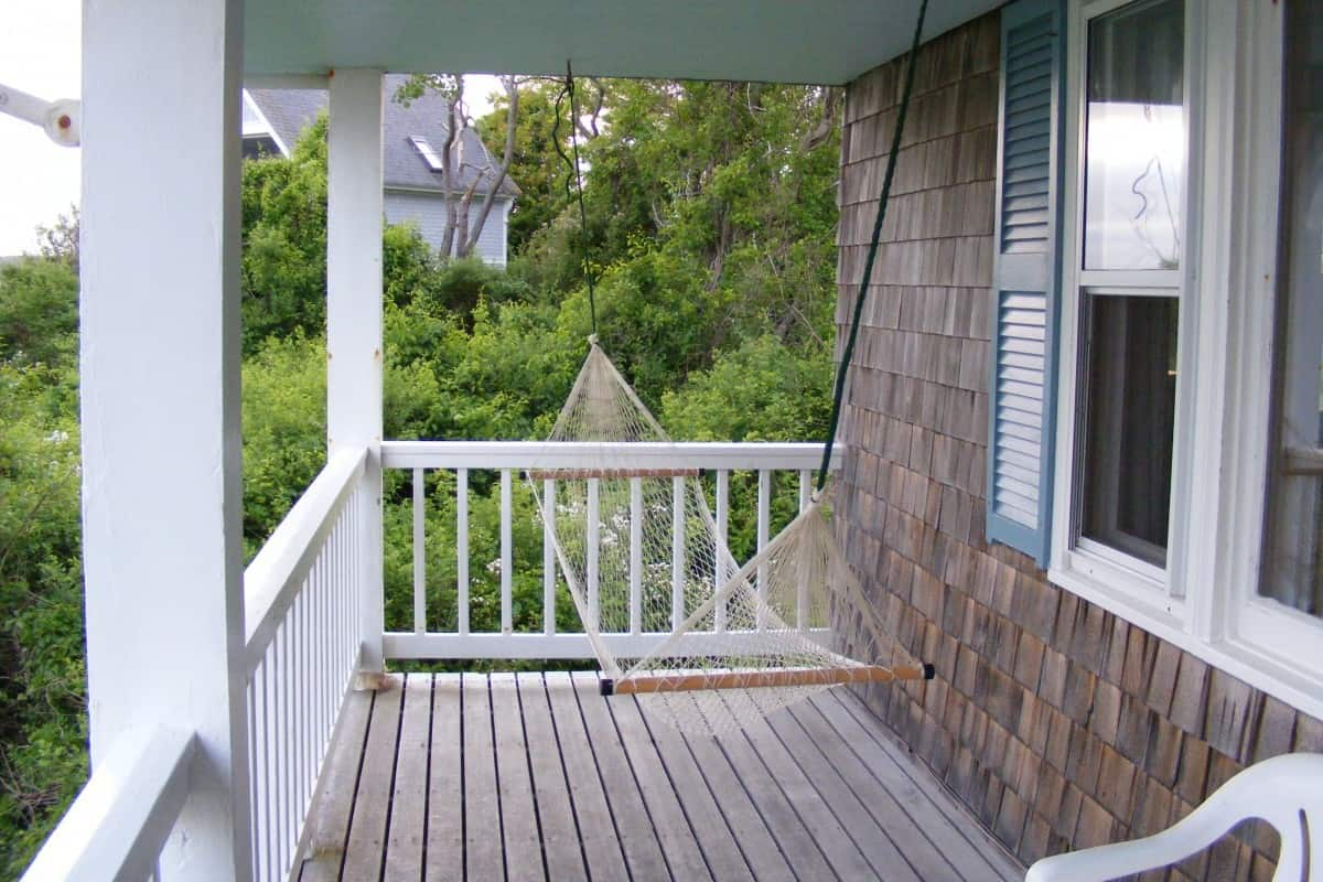 deck villa house home porch summer vacation balcony relax cottage peaceful backyard patio property exterior swing relaxation estate real estate front porch outdoor structure